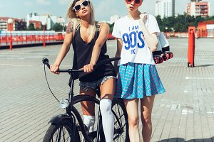 young girls with bicycle