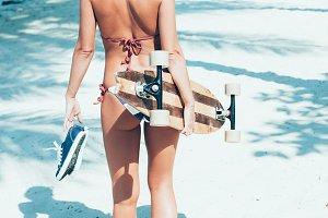woman with longboard
