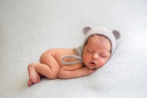 Newborn baby boy naked lies