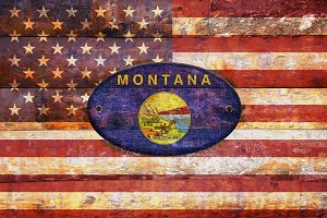USA and Montana flags.