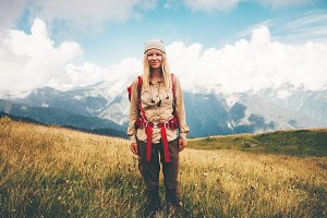 Girl Traveler hiking at mountains