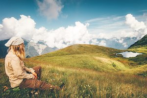 Woman Traveler relaxing at mountains