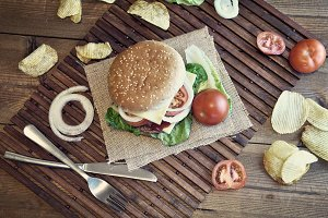 hamburger with cheese, tomato, onion