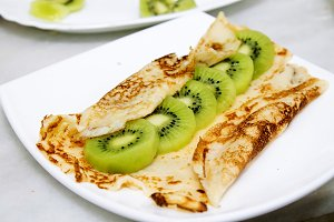 crepes and pancakes with fruit, whipped cream and chocolate