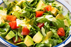 Healthy avocado spinach tomato salad