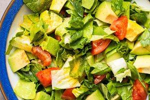 Healthy avocado spinach tomato salad