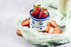 Strawberries in vintage enamal mug