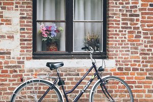 Bicycle in front of brick house