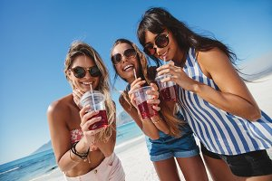 Friends on the beach drinking