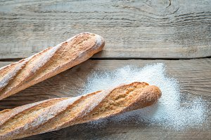 Two baguettes on the wooden table
