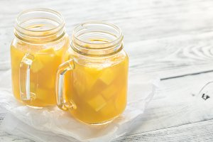 Mango juice in mason jars