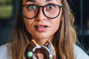 Funny woman holding donut