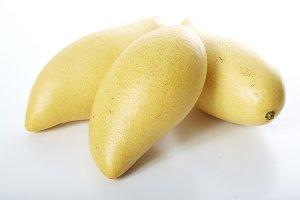 Yellow mango  on a white  background