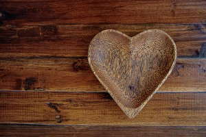 Wooden plate heart shape on wooden table
