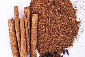Cinnamon Sticks and Powder on white