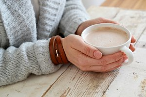 Woman's Hands Holding Warm Drink