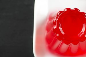 Top view of strawberry jelly on white plate.