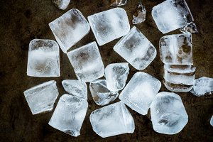 Frozen Ice Cubes on Rustic Background