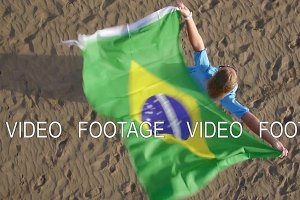 Aerial view of woman with Brazilian flag and nature scene