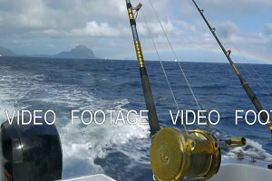Fishing rods on sailing motor boat
