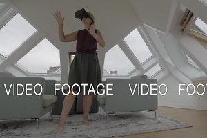 Woman entertaining with VR-headset in Cube House