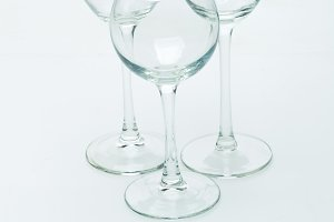 Grapes and three glasses for wine on a white background, studio light