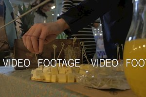 Man taking cheese from buffet table