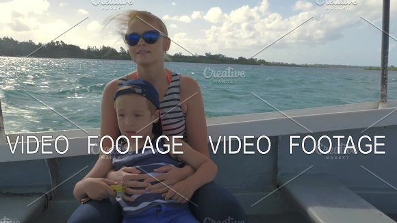 Mother and child having speedy boat travel