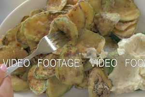 Fried zucchini with cream sauce