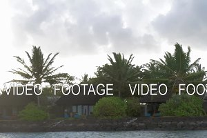 View of moving along coast with luxury bungalow hotel against cloudy sky, Mauritius Island