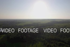 Aerial landscape with forests, fields and village in Russia