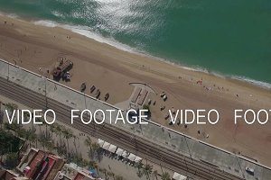 Aerial top view of beach, sea, railways and hotels, Barcelona, Spain