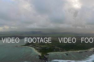 Flying over Mauritius Island with low clouds