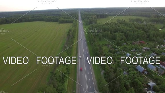 Aerial Shot Of Transport Traffic On Countryside Road