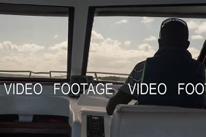 Timelapse of a captain steering a yacht