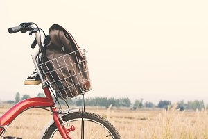 Jeans sneakers and bag on bicycle