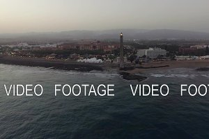Maspalomas Lighthouse and resort on the coast, aerial
