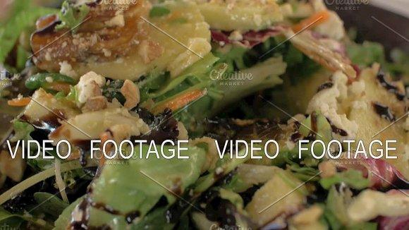 Eating Mixed Green Salad