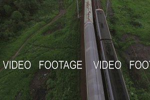 Aerial bird eye view of two railway different direction and moving trains, Russia