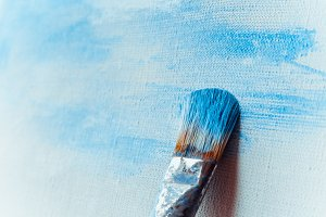 Paint brush on a painted canvas