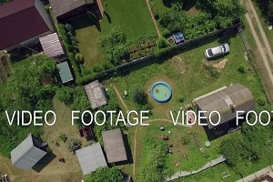 Children in the pool and village aerial shot
