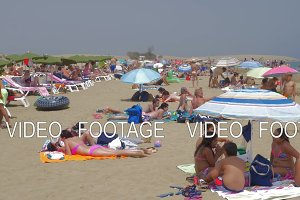 People relaxing on the beach of Gran Canaria