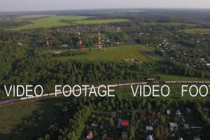Summer houses in the countryside and freight train, aerial view