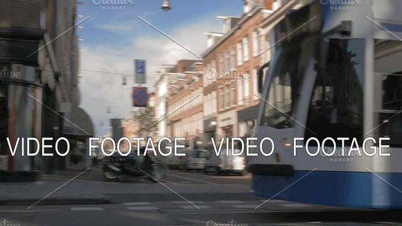 Street With Moving Tram In Amsterdam