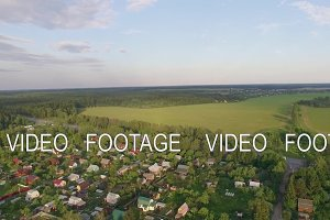 Aerial shot of village, highway and green nature in Russia