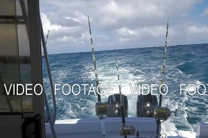 Yachts with fishing tackles sailing in ocean