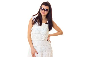 Young woman in lace dress with sunglasses