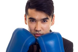 Young man in suit with boxing gloves