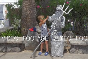 Boy and living statue of Neptune