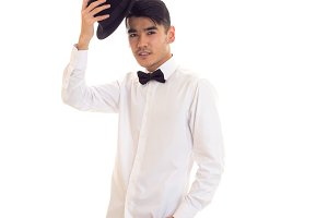 Young man in white T-shirt with black hat